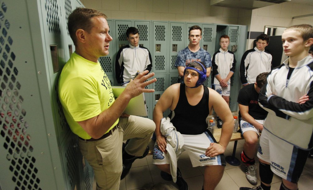 Bryan Thompson, left, who took over as the Traip Academy wrestling coach 17 years ago, now co-coaches the co-op team with York, and hopes the sport will continue to take off at Traip. Meanwhile, the Traip wrestlers are competing on the team with York.