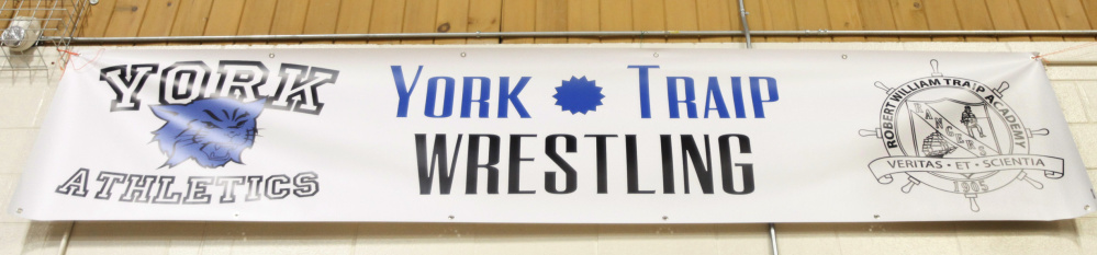 A York Traip wrestling sign is hanging this season at York High. This is the first year in which schools are allowed to create cooperative wrestling teams.