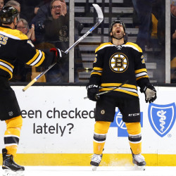 The Bruins' Max Talbot celebrates his first-period goal against the Penguins with teammate Jimmy Hayes. The goal was all Boston needed as it shut out Pittsburgh, 3-0.