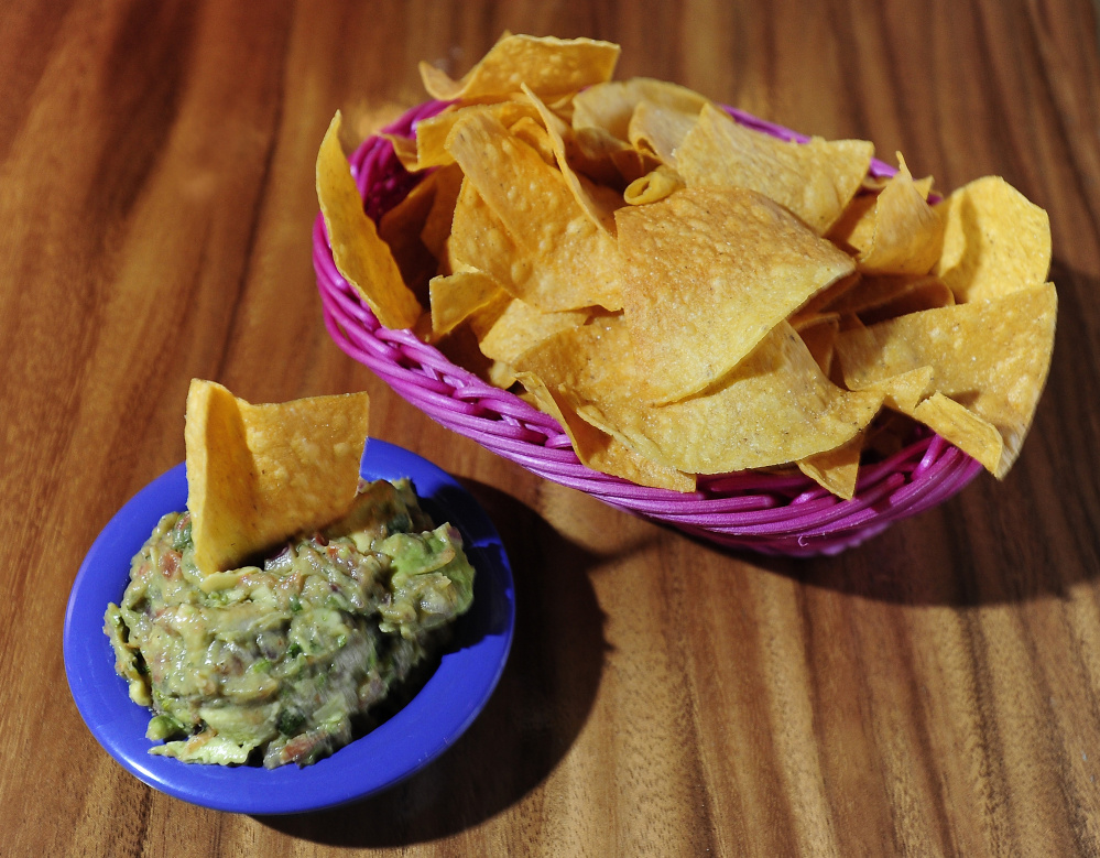 Chips and guacamole whet the appetite with bright, tart flavors and a bit of heat.
