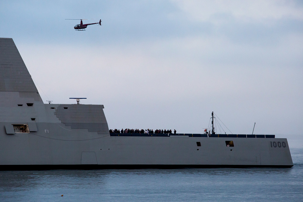 The Zumwalt-class guided-missile destroyer makes its way through Portland Harbor toward the Ocean Gateway Terminal on Thursday. Dignitaries, Navy officials, and others were on deck as a helicopter flew overhead taking photographs.