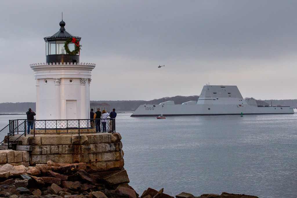 Spectators watch from Bug Light in South Portland as the Zumwalt-class guided-missile destroyer makes its way into Portland Harbor on Thursday.
