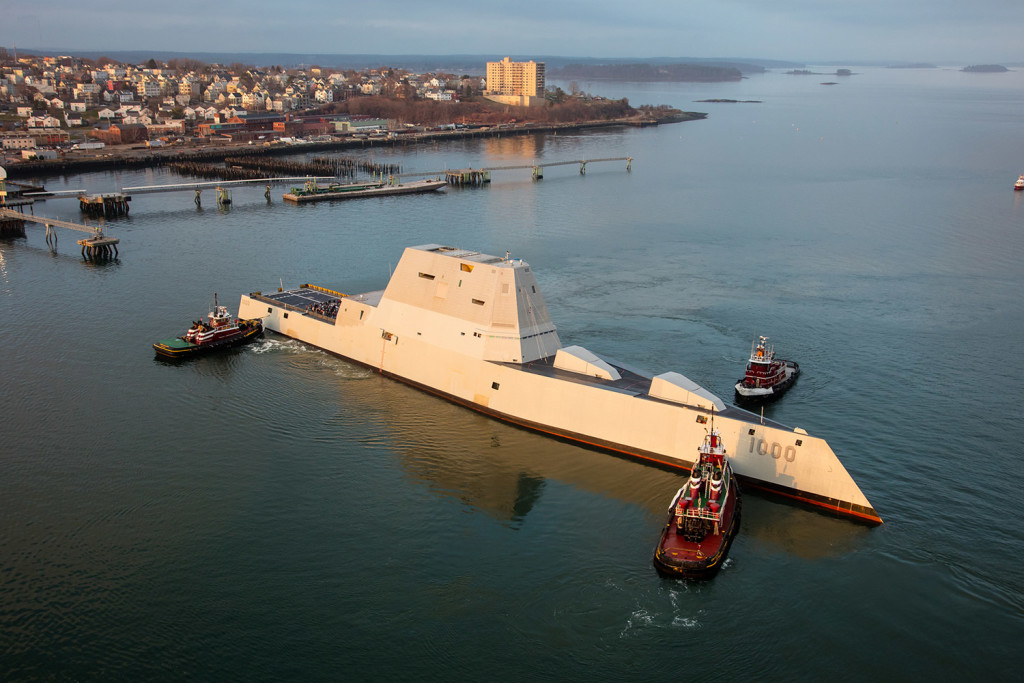 Tugboats turn the Zumwalt as it arrives unannounced in Portland Harbor in December during sea trials. Photo by Dave Cleaveland Maineimaging.com
