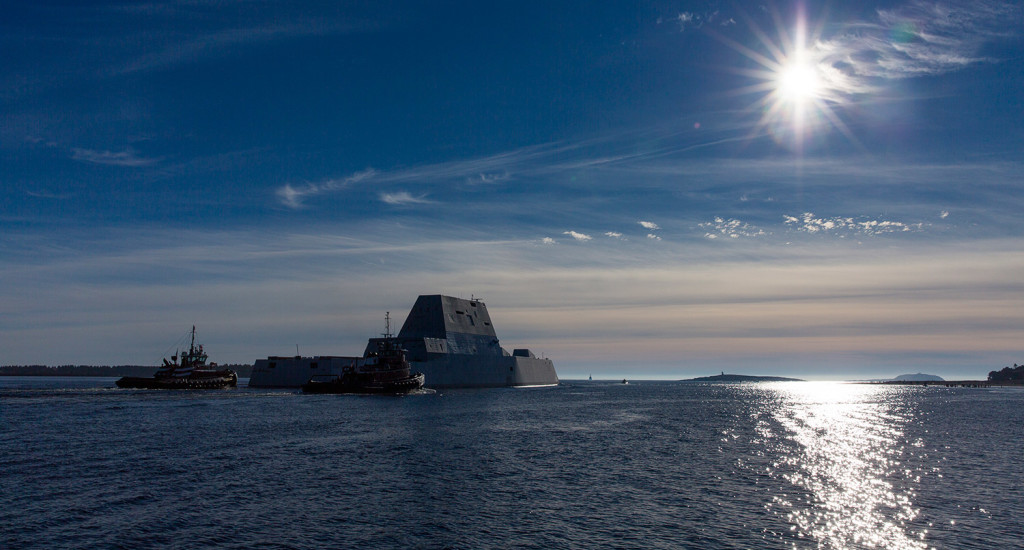 The morning sun glistens across the water as the Zumwalt exits the Kennebec River toward the Atlantic.