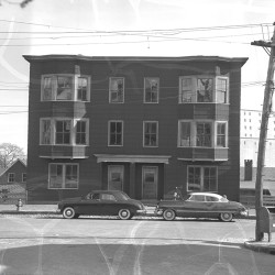 A Press Herald photograph from 1954 shows an apartment building on Adams Street in the Munjoy Hill neighborhood before it and many other homes on the same block were demolished in an urban renewal project.