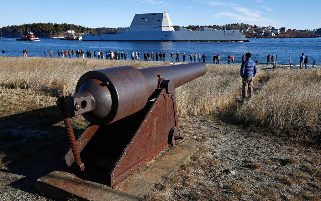 The USS Zumwalt leaves the Kennebec River, passing a crowd of spectators near Fort Popham, a Civil War-era fortification, on Monday in Phippsburg.