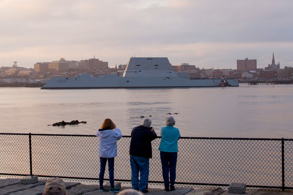 The Zumwalt-class guided-missile stealth destroyer built at Bath Iron Works makes its way into Portland Harbor as seen from Bug Light in South Portland on Thursday.