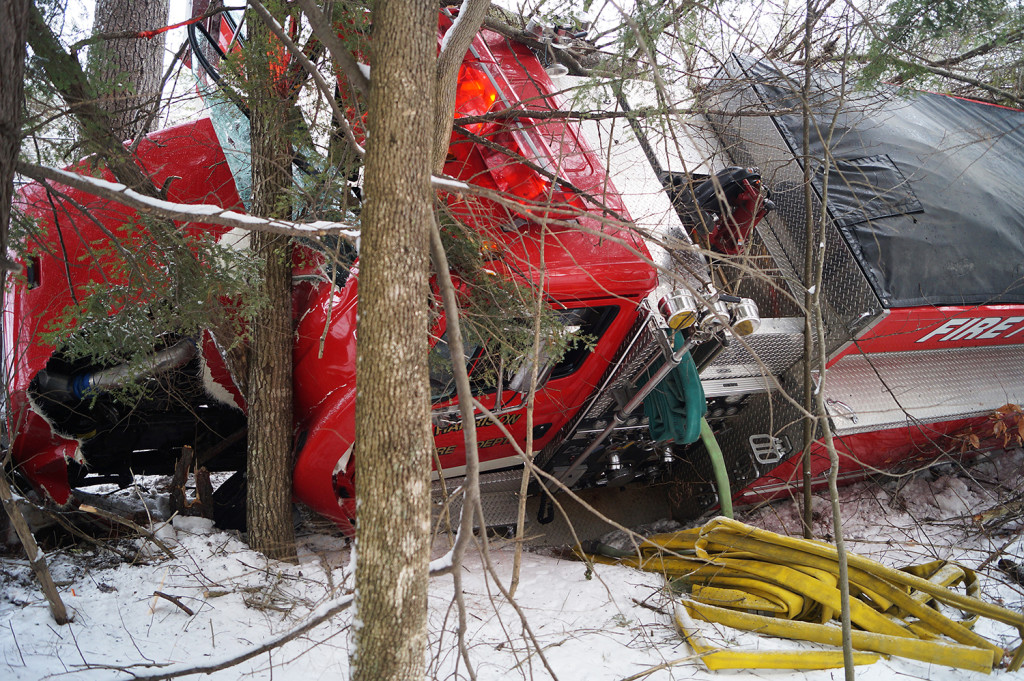 A Harrison firetruck rests against a tree after rolling over on a icy private road. Photo courtesy of Chuck Blaquiere
