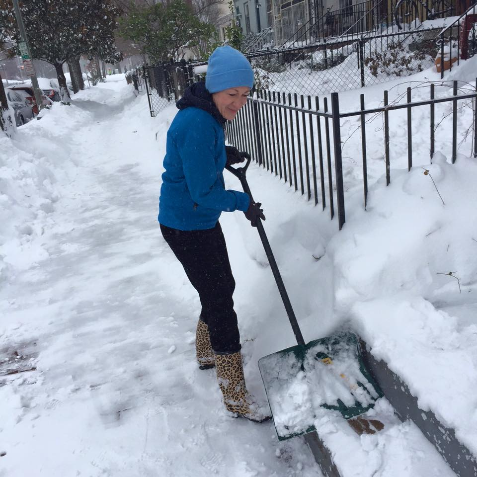 Sen. Susan Collins shovels snow in front of her Washington, D.C. townhouse after last week's blizzard. Collins posted the photo on her Facebook page.