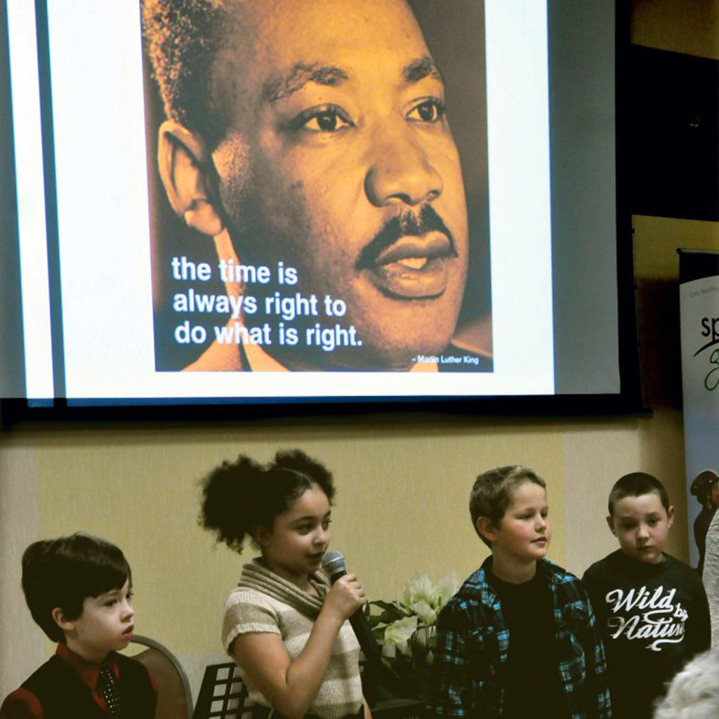 Students from the George Mitchell School, including Isabella Bohner, center, recite passages during the Martin Luther King Jr. breakfast celebration at the Muskie Center in Waterville on Monday.