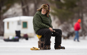 """NORTH WATERBORO, ME - JANUARY 26: Al Bates, 81 of Alfred, watches a trap while jigging for fish at Little Ossipee Lake in North Waterboro on Tuesday January 25, 2016. """"I've got some good ones here in the past, but its the first time I've fished here this year because of the ice, said Bates. (Photo by Carl D. Walsh/Staff Photographer)"""