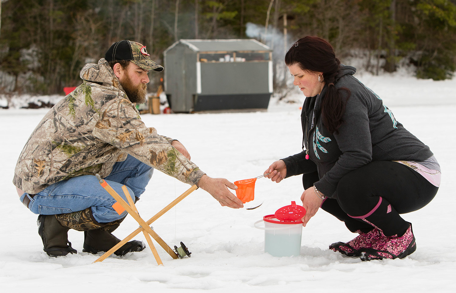 Maine 39 s fishing derbies on thin ice this winter portland for Ice fishing maine