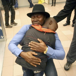Haroun Adam, 35, embraces his son Mohamed, 9, as his family arrives at the Portland International Jetport on Dec. 17. Adam waited almost five years to be reunited with his wife and four sons.