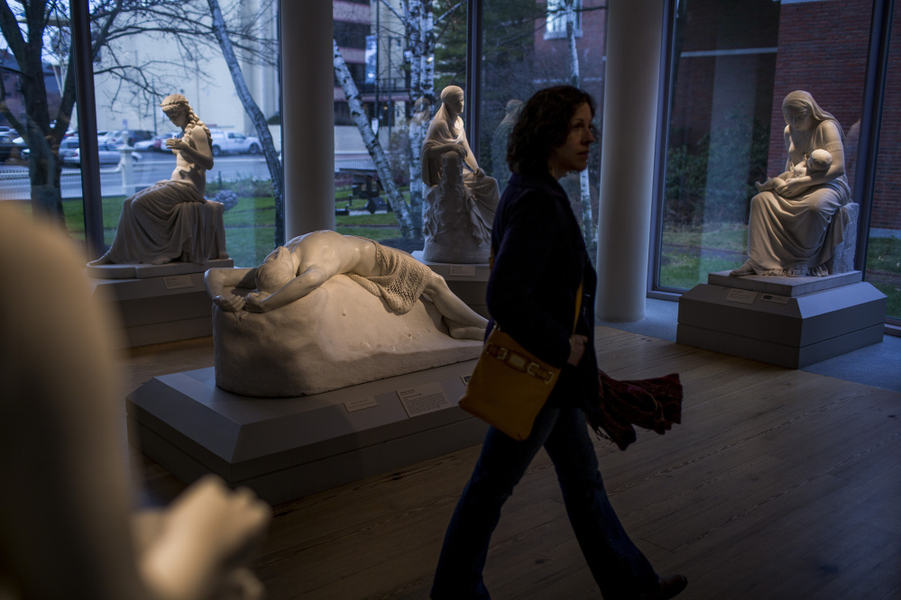 Hannele Lahti of Manassas, Va., strolls through a Portland Museum of Art sculpture gallery last month. The museum will make improvements during its three-week January closure, including adding a gallery and a study room and displaying art in more places.