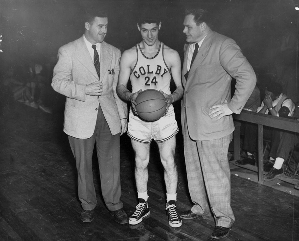 Ted Shiro is shown with Colby head basketball coach Lee Johnson, right, and an unidentified coach at left. Shiro was the first Colby basketball player to score 1,000 points.