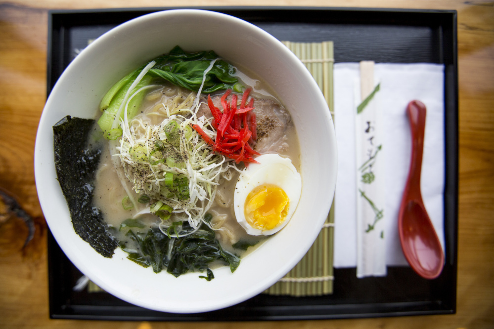 Hakata-style ramen – one of three hot noodle dishes at Ramen Suzikaya – is topped with pork, a soft-boiled egg, pickled ginger and more.