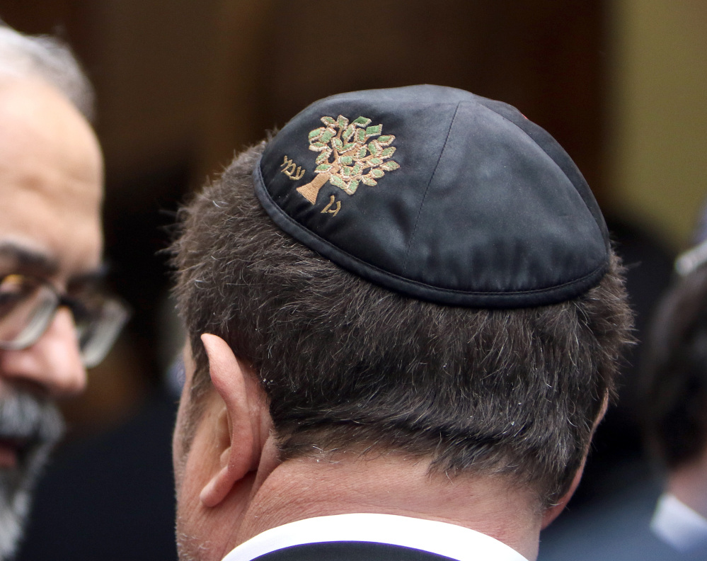 A member of the Jewish authority waits outside during a visit from Interior Minister Bernard Cazeneuve at the synagogue in Marseille on Thursday.