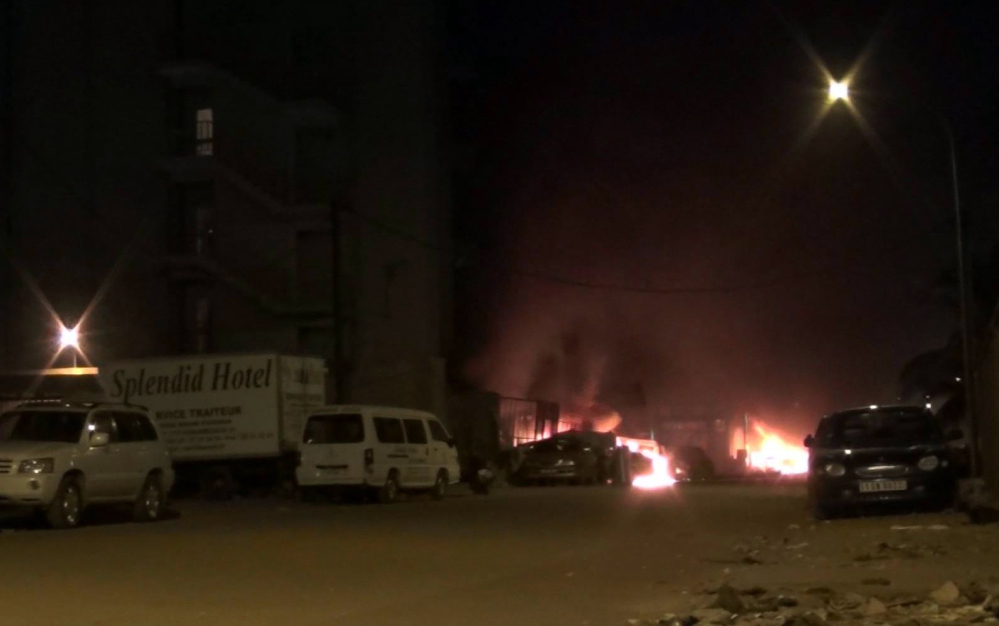 This still taken from video by Associated Press Television shows the scene of an attack on a hotel in Ouagadougou, Burkina Faso, on Friday.  Attackers struck an upscale hotel popular with Westerners in Burkina Faso's capital.