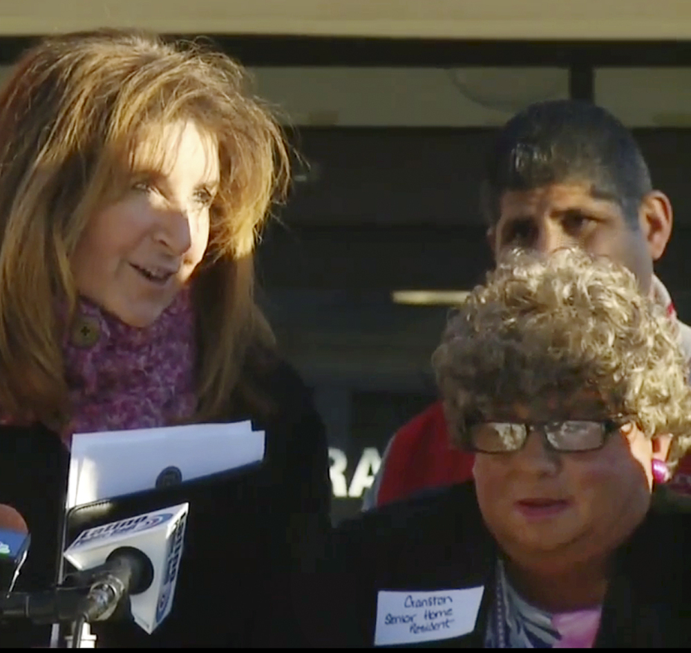 In this Jan. 5 still image from video, Sue Stenhouse, left, speaks alongside a man dressed as a woman during a news conference in Cranston, R.I.