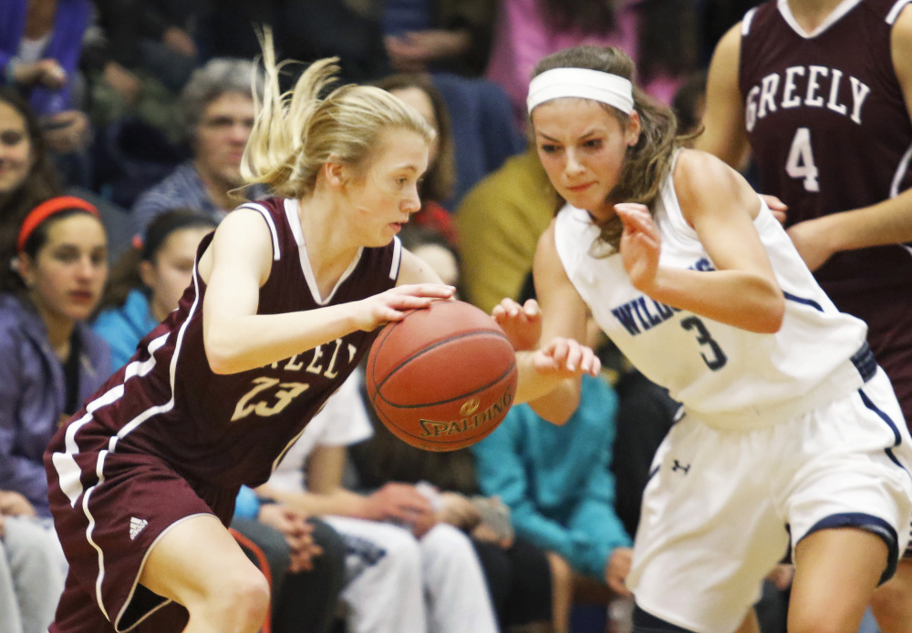 Greely's Anna DeWolfe drives against Lily Posternak of York during their Class A South girls' basketball game Friday in York. DeWolfe scored 19 points, but York improved to 12-0 with a 69-66 victory.