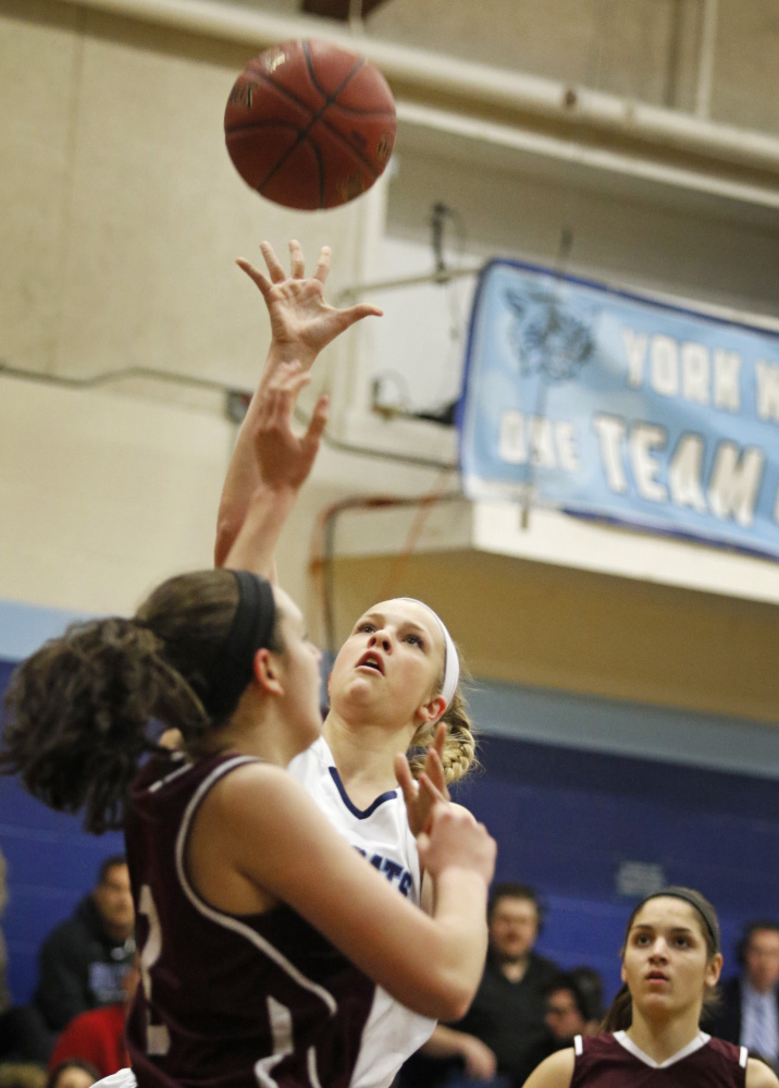 YORK - JANUARY 15:  York #20 Chloe Smedley sends up a shot over Greely #3 Moira Train (cq) during first half basketball at York. (Photo by)