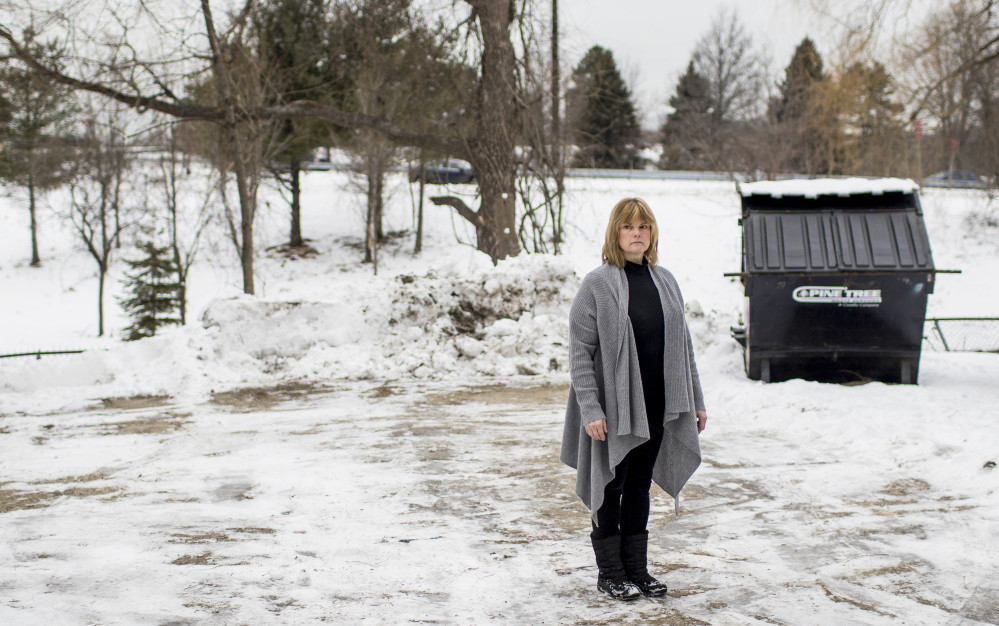 Cynthia Callnan, who says two rats crawled over her feet in broad daylight when she brought trash to the Dumpster outside her apartment building, is one of many to complain to city and state officials about an infestation in the Libbytown neighborhood.