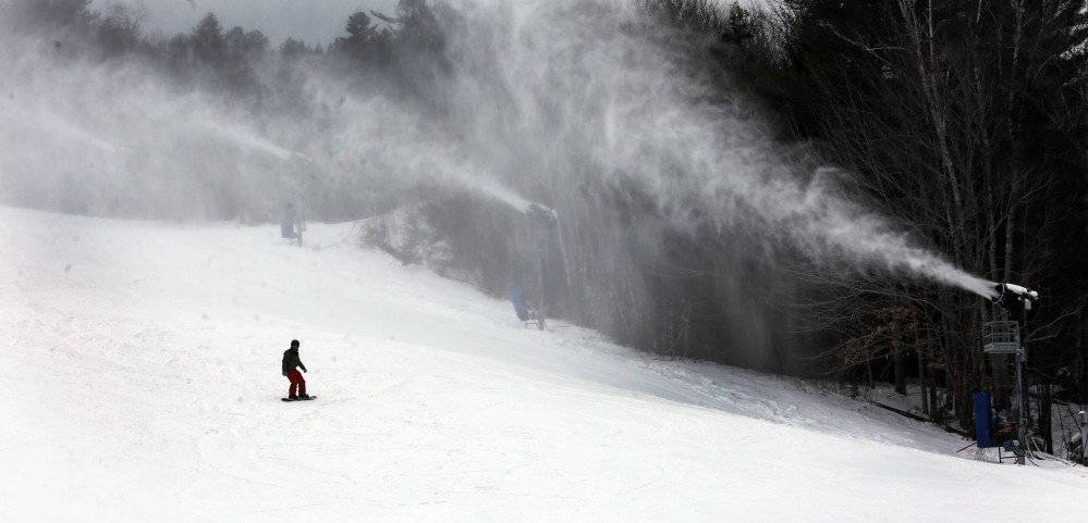A snowboarder makes his way down the mountain Friday at Attitash ski area in Bartlett, N.H. New England ski resorts are hoping the fresh snow this weekend will help make up for poor business during the warm Christmas season.