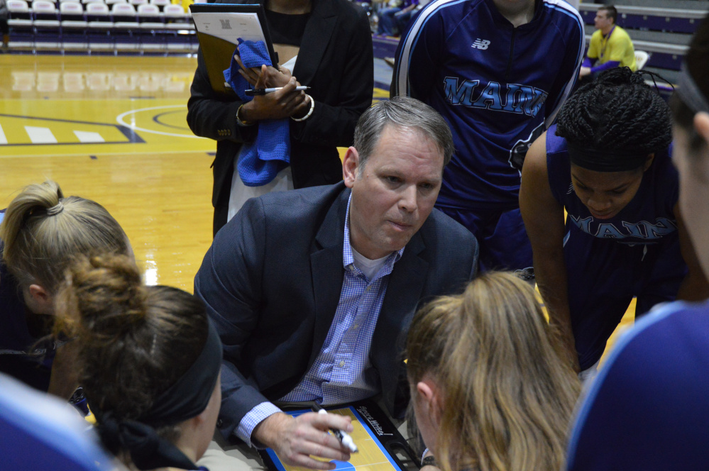 UMaine women's basketball coach Richard Barron talks to his team during a timeout against Albany on Saturday in Albany, N.Y. Fran Sypek photo