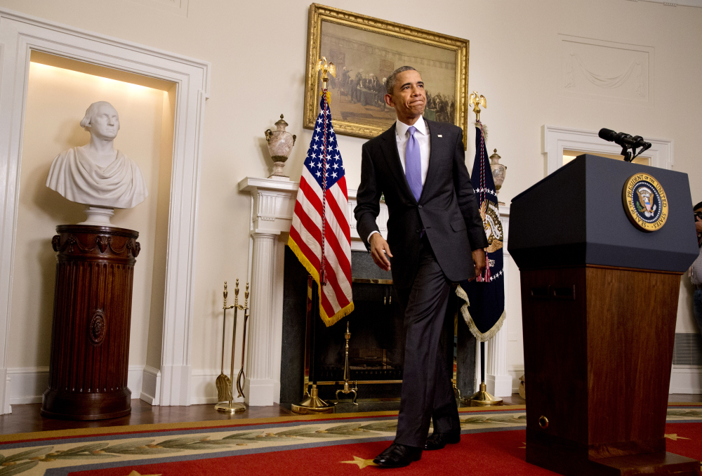President Obama leaves the podium after speaking about the release of Americans by Iran, on Sunday at the White House.