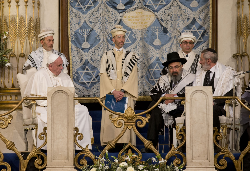 Pope Francis sits with Rabbi Riccardo Di Segni, right, during his visit to the Great Synagogue of Rome on Sunday.