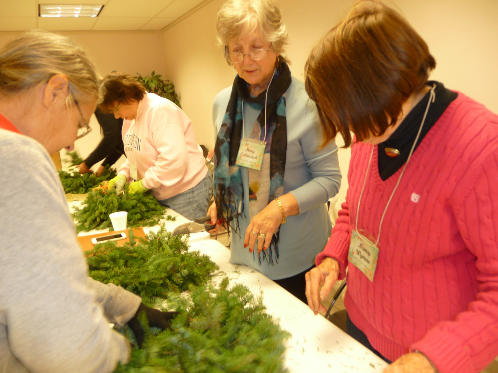 Members of the Southern Maine Garden Club participate in an evergreen wreath making workshop during the Christmas season.The group will gather again on Wednesday to learn about planting blueberries, raspberries and peaches. Photo courtesy Donna Claveau