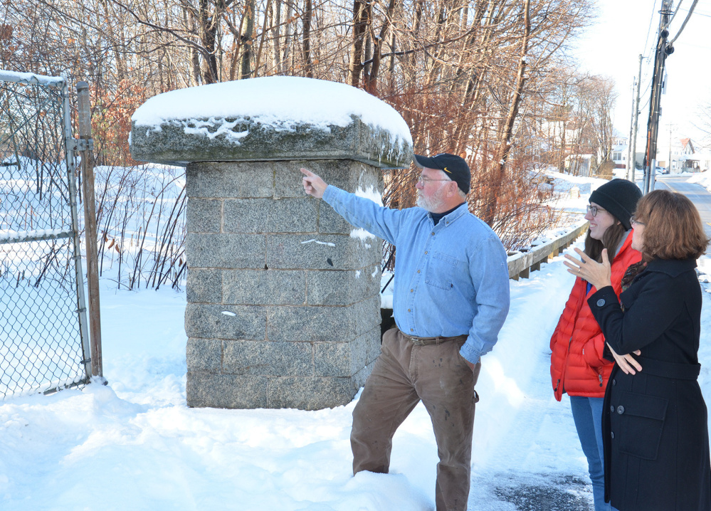 Dana Peck, owner of Maine Architectural Ironworks, is donating his labor to design the new gateway to Clifford Park. With him at the park are Katie Labbe, the city's Adopt-A-Park coordinator, center, and Catherine Glynn, a park trail steward.