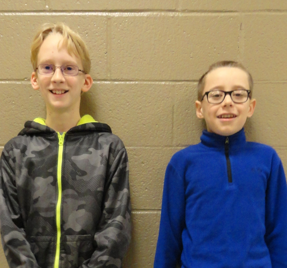 Sixth-grade Saco Middle School students Will Barry, left, and Henry Clark were named winner and runner-up, respectively, in a schoolwide spelling bee. Both will advance to the York County Spelling Bee in February.