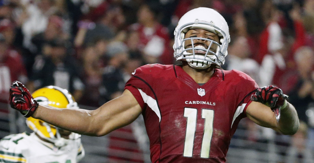 Larry Fitzgerald's 75-yard yard reception to start overtime set up his 5-yard TD catch that ended a wild 26-20 win over Green Bay in the divisional round Saturday.