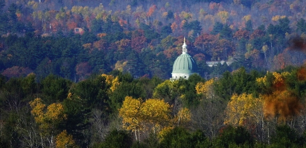 The State House dome is seen in front of Howard Hill. Augusta will hold a meeting Tuesday to discuss possible recreational uses for the property, which cost $925,000.