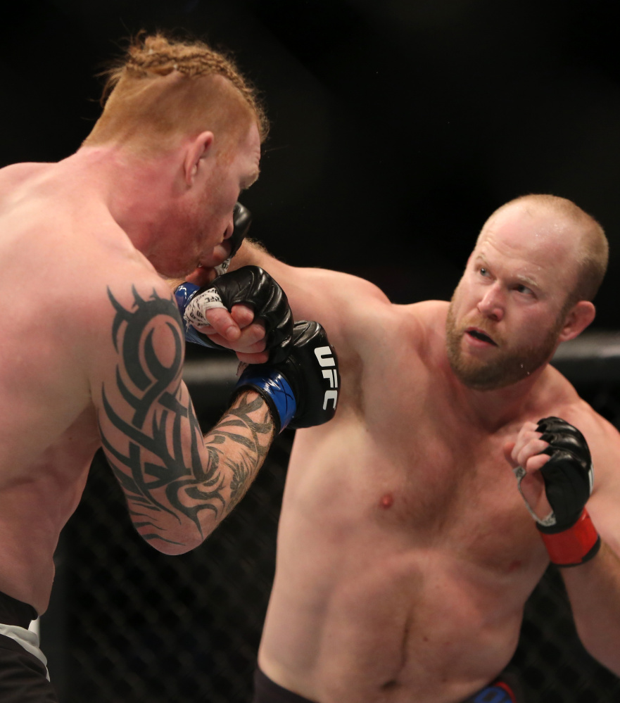 Tim Boetsch, right, of Lincolnville looks for an opening Sunday night against Ed Herman during a UFC fight in Boston. Herman won by second-round knockout.