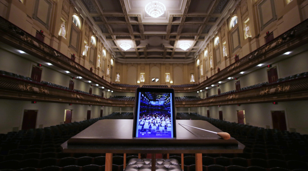 An iPad with a Boston Symphony Orchestra interactive program is displayed on the conductor's stand at Symphony Hall in Boston.