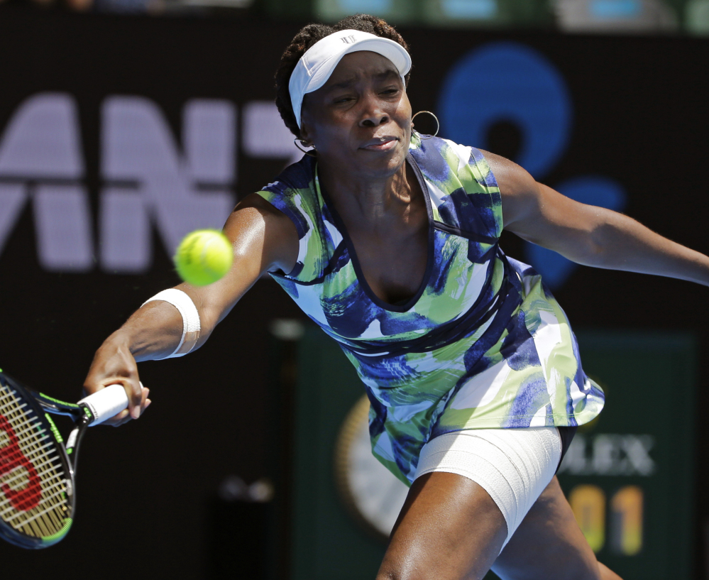 Venus Williams reaches for a forehand return to Johanna Konta during a first-round match at the Australian Open in Melbourne on Tuesday.
