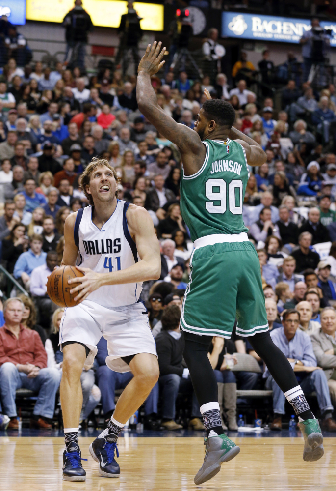 Mavericks forward Dirk Nowitzki was tough on the Celtics down the stretch, scoring 14 points in the fourth quarter and seven more in overtime.