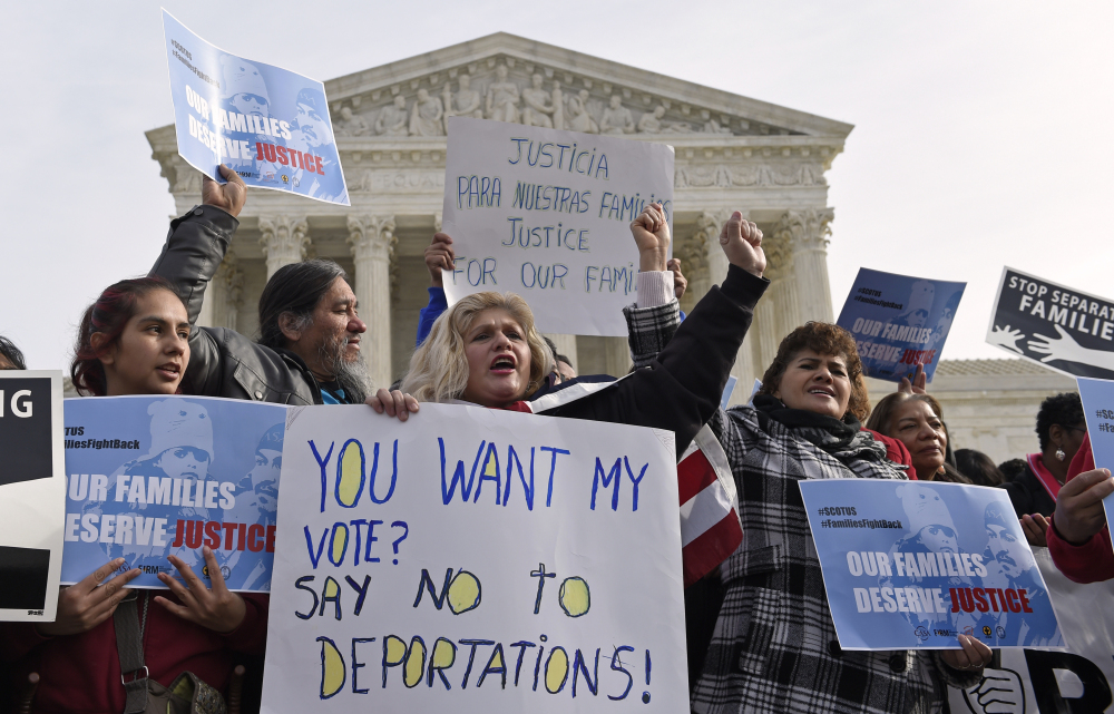Members of CASA de Maryland participate in a immigration rally outside the Supreme Court in Washington, Friday.