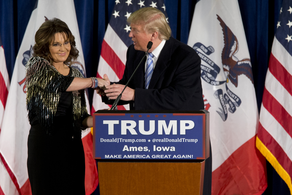 """Former Alaska Gov. Sarah Palin endorses Republican presidential candidate Donald Trump on Tuesday during a rally at Iowa State University. """"He's going rogue left and right,"""" she told the audience. """"That's why he's doing so well."""""""