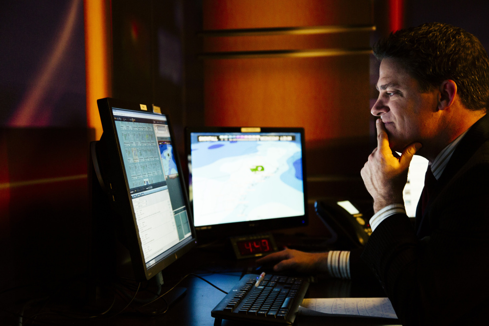 WCSH weatherman Tom Johnston reviewing  forecast data in 2016