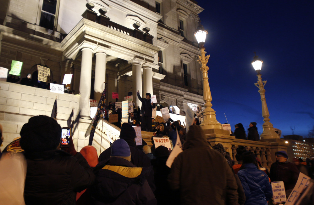Protesters gather outside the state Capitol before Michigan Gov. Rick Snyder's State of the State address Tuesday night in  Lansing, Mich., where the Flint water crisis threatens to overshadow nearly everything else he has accomplished.