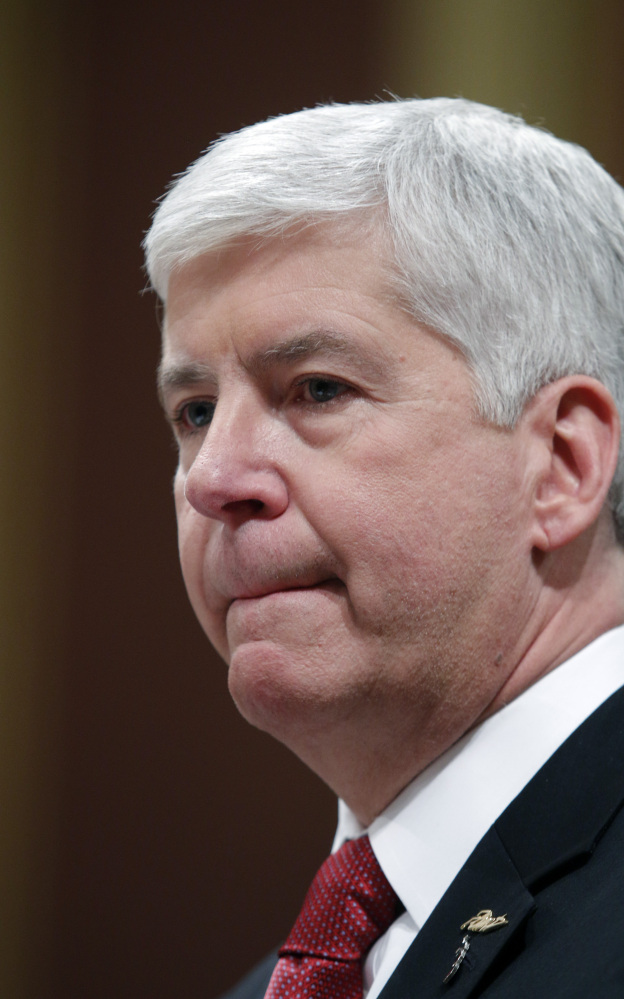 GOV. RICK SNYDER pauses as he delivers his State of the State address to a joint session of the House and Senate, Tuesday, Jan. 19, 2016, at the state Capitol in Lansing, Mich. With the water crisis gripping Flint threatening to overshadow nearly everything else he has accomplished, the Republican governor pledged a fix Tuesday night during his annual State of the State speech. (AP Photo/Al Goldis)