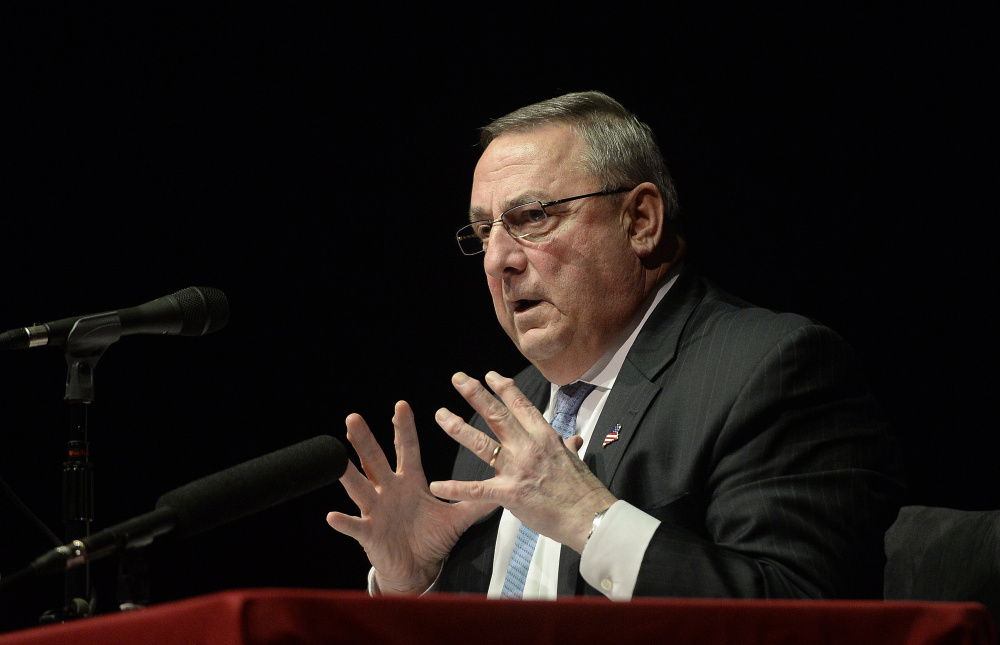 Gov. Paul LePage speaks at Windham High School on Jan. 19. . He urged the audience to vote their state legislators out of office in November if they don't follow through on their campaign promises.