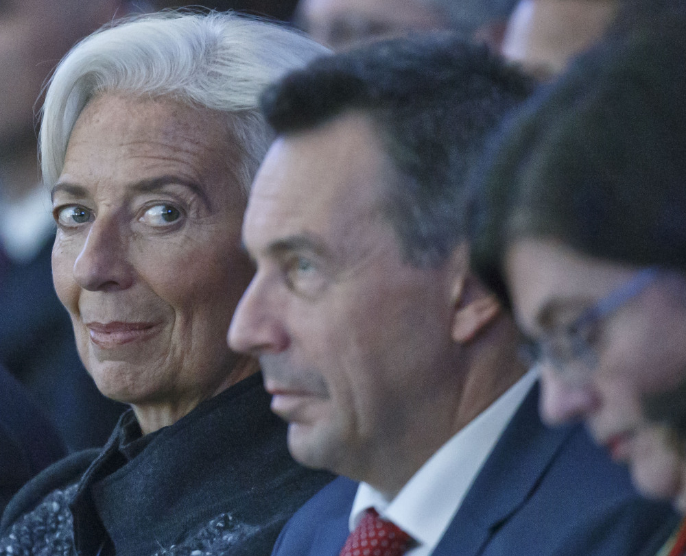 International Monetary Fund managing director Christine Lagarde, left, attends the plenary session of the World Economic Forum in Davos, Switzerland, Wednesday.