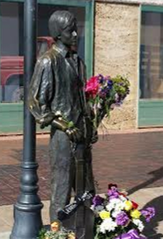 "Standin' on the corner in Winslow, Ariz., is a statue depicting the late Glenn Frey, the Eagles musician who co-wrote with Jackson Browne ""Take It Easy."" – The Associated Press"