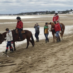 Guided horseback riding on Old Orchard Beach is among the activities for children at the annual Fire and Ice Burn Survivors Winter Camp, largely run by volunteers from fire departments. Susan Kimball photo