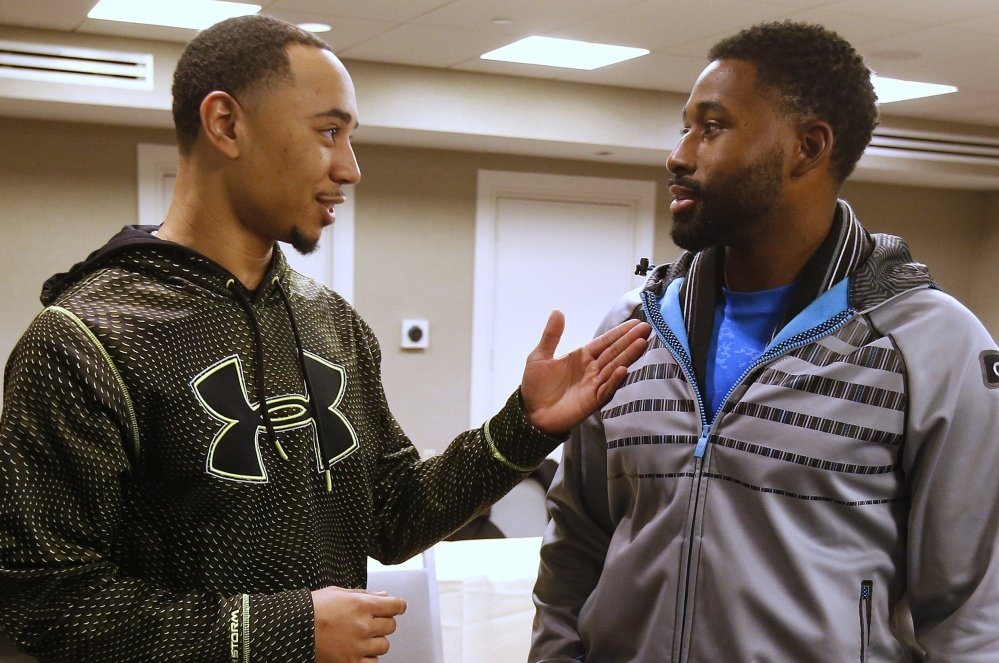Mookie Betts, left, talks with Red Sox teammate Jackie Bradley Jr., during media availability before the Boston chapter of the Baseball Writers Association of America's awards dinner in Boston on Thursday.