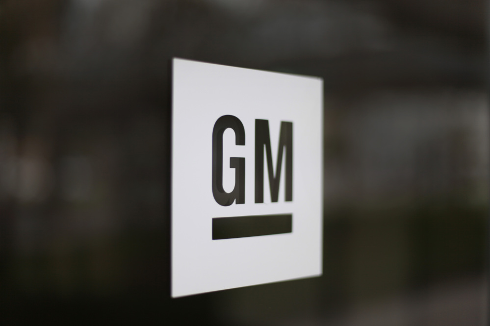 """FILE - This Friday, May 16 2014, file photo, shows the General Motors logo at the company's world headquarters in Detroit. The final destination is a mystery, but General Motors is taking another step on its fast-moving journey into new ways of getting around. The company on Thursday, Jan. 21, 2016, announced that it's formed a brand called """"Maven"""" that will run its car-sharing ventures, including a new one that will begin competing with ZipCar next month in Ann Arbor, Michigan, and spread to other metro areas later this year. (AP Photo/Paul Sancya, File)"""